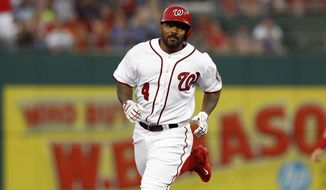 Washington Nationals' Howie Kendrick (4) heads to third after hitting a solo home run during the third inning of a baseball game against the Los Angeles Angels, Tuesday, Aug. 15, 2017, in Washington. (AP Photo/Carolyn Kaster) **FILE**