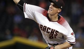Arizona Diamondbacks starting pitcher Zack Greinke throws against the Houston Astros during the first inning of an interleague baseball game, Monday, Aug. 14, 2017, in Phoenix. (AP Photo/Matt York)
