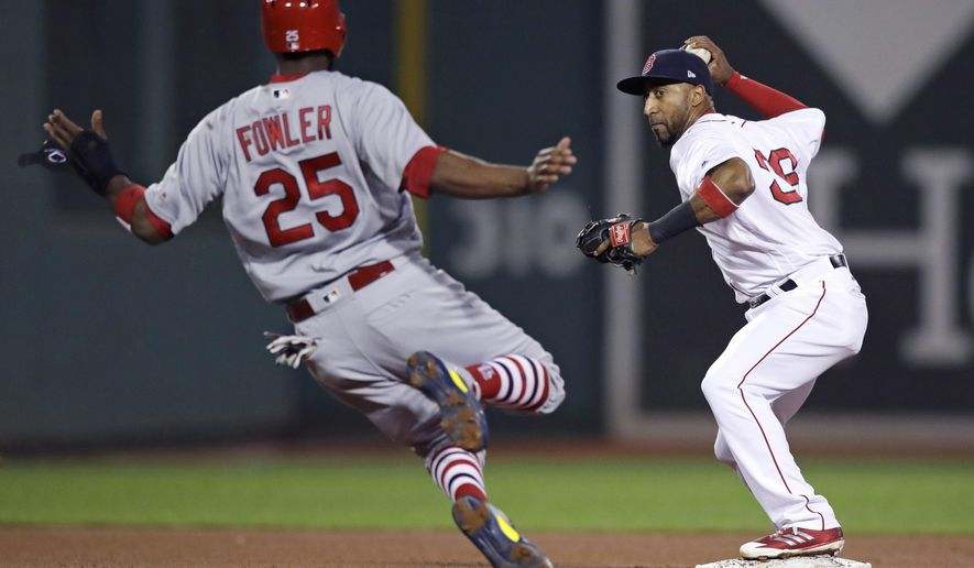 Boston Red Sox second baseman Eduardo Nunez, right, forces out St. Louis Cardinals' Dexter Fowler for the second out of a triple play during the fourth inning of a baseball game in Boston, Tuesday, Aug. 15, 2017. (AP Photo/Charles Krupa)