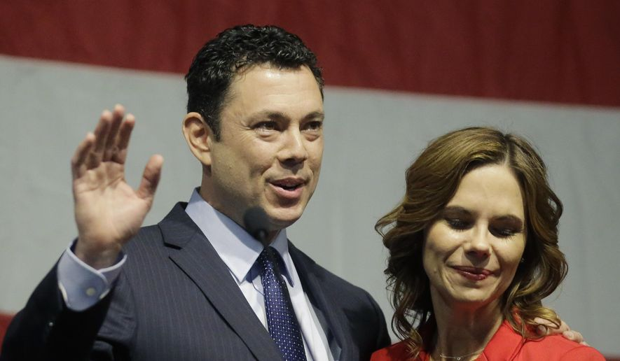 This May 20, 2017, file photo shows then-Rep. Jason Chaffetz waving to the Utah GOP Convention while his wife Julie looks on in Sandy, Utah. (AP Photo/Rick Bowmer, File)