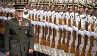 Joint Chiefs Chairman Gen. Joseph Dunford reviews a Chinese honor guard during a welcome ceremony at the Bayi Building in Beijing, Tuesday, Aug. 15, 2017. (AP Photo/Mark Schiefelbein, Pool)