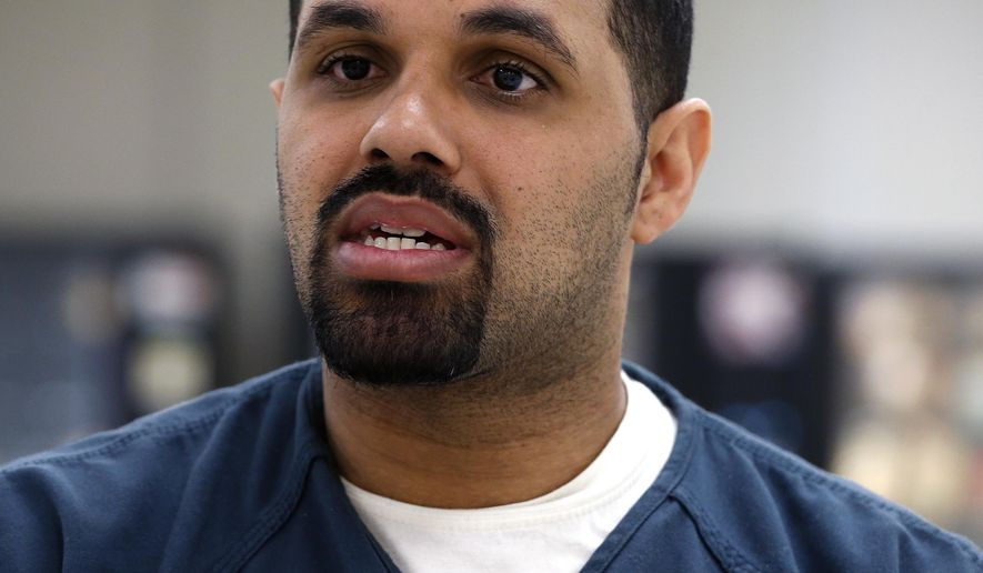 FILE - In this May 7, 2014 file photo, Rene Lima-Marin talks with The Associated Press about being sent back to prison after being mistakenly released 90 years early during an interview at the Kit Carson Correctional Center, a privately operated prison in Burlington, Colo. The Cuban immigrant was re-released from prison earlier this year and pardoned by Gov. John Hickenlooper to prevent his deportation. His lawyers say he has won a second chance to argue why he should be allowed to stay in the United States. (AP Photo/Brennan Linsley, File)