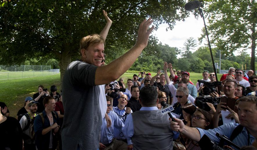 Former Louisiana State Representative David Duke arrives to give remarks after a white nationalist protest was declared an unlawful assembly, Saturday, Aug. 12, 2017, in Charlottesville, Va. The nationalists were holding the rally to protest plans by the city of Charlottesville to remove a statue of Confederate Gen. Robert E. Lee. (Shaban Athuman /Richmond Times-Dispatch via AP)