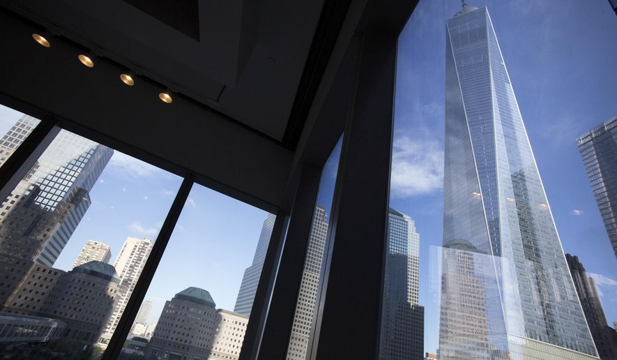 FILE - In this Aug. 15, 2016, file photo, window seating in the Eataly restaurant offers a view of One World Trade Center, right, in New York. On Tuesday, Aug. 15, 2017, the Federal Reserve Bank of New York issues its Empire State manufacturing index for August. (AP Photo/Mark Lennihan, File)