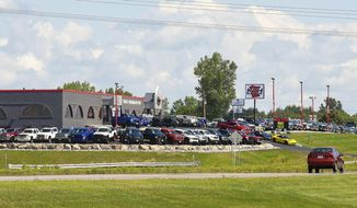 ADVANCE FOR MONDAY, AUG. 21 2017 Minnesota Truck Headquarters recently moved into their new location on Minnesota Highway 23 shown Friday, Aug. 11, 2017, in St. Cloud, Minn. The business has consolidated their locations into the former Honda House location. (Jason Wachter/St. Cloud Times via AP)