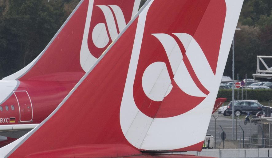 FILE -In this Sept. 29, 2016 file photo shows an  aircraft of the Air Berlin company on the runway of Dusseldorf airport in Germany. Struggling German carrier Air Berlin says it's filing for bankruptcy after its main shareholder, Abu Dhabi-based Etihad, said it would make no more financing available. The Economy Ministry and Transport Ministry said Tuesday Aug. 15, 2017  in a statement that the airline would get a loan of 150 million euros ($177 million) so that it can continue flights for the time being.  (Bernd Thissen/dpa via AP,file)