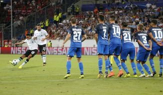 Liverpool's Trent Alexander-Arnold, left, scores his side's opening goal with a free kick during a Champions League's qualifier first leg soccer match between 1899 Hoffenheim and FC Liverpool, in the Rhein-Neckar-Arena, in Sinsheim, Germany, Tuesday, Aug. 15, 2017. (AP Photo/Michael Probst)