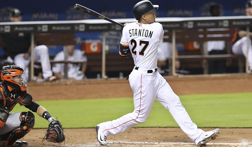 Miami Marlins right fielder Giancarlo Stanton looks on as he hits a solo home run during the third inning of a baseball game against the San Francisco Giants, Tuesday, Aug. 15, 2017 in Miami. (Pedro Portal/Miami Herald via AP)