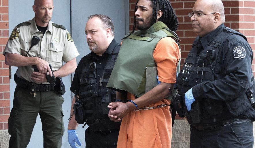 FILE - In this May 10, 2017, file photo, Wesley Correa-Carmenaty is led into the Woodbury County Jail in Sioux City, Iowa. Correa-Carmenaty, who is charged with killing a sheriff's deputy and wounding another while escaping from an Iowa jail, entered guilty pleas Tuesday, Aug. 15, 2017, to murder, attempted murder, escape, kidnapping and other crimes. His trial was set to begin Tuesday, but his attorney informed authorities last week that Correa-Carmenaty would change his plea in Pottawattamie County District Court in Council Bluffs. (Tim Hynds/Sioux City Journal via AP)