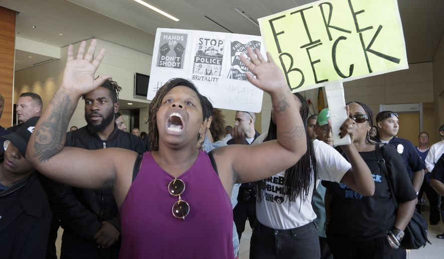 FILE--In this Oct. 3, 2016, file photo, protesters demand the firing of Los Angeles Police Chief Charlie Beck over a police-involved shooting of a black man over the weekend during a news conference at LAPD headquarters in Los Angeles. A civilian oversight board has found Tuesday, Aug. 15, 2017, that Los Angeles police officers acted within policy in the fatal shooting of an 18-year-old man that sparked several Black Lives Matter protests. (AP Photo/Nick Ut, file)