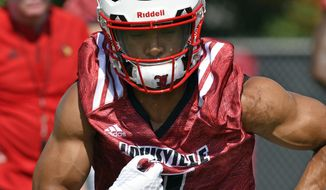 FILE - In this July 31, 2017, file photo, Louisville running back Reggie Bonnafon (7) participates in drills at the start of an NCAA college football practice, in Louisville, Ky. Before Lamar Jackson there was Reggie Bonnafon at quarterback for Louisville, who moved on to work at running back and receiver since the eventual Heisman Trophy winner took over in 2015. After playing primarly at wideout last year, the senior is listed No. 1 in the backfield in another switch that seems to have provided the best fit. (AP Photo/Timothy D. Easley, File)