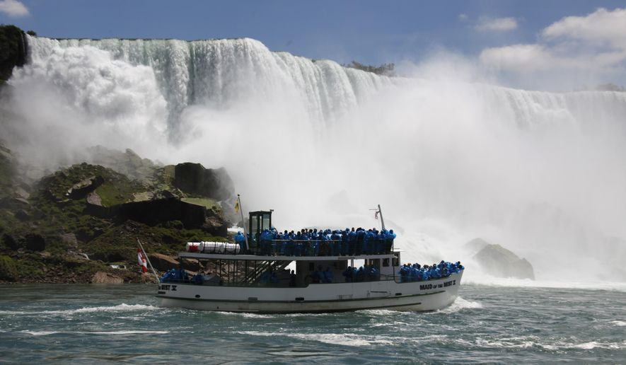FILE - In this June 11, 2010 file photo, tourists ride the Maid of the Mist tour boat at the base of the American Falls in Niagara Falls, N.Y.   Local lawmakers are asking for a criminal investigation into the discharge of wastewater that turned the water below Niagara Falls black. The Niagara County Legislature passed resolutions Thursday, Aug. 10, 2017  that request investigations by the New York state attorney general, the Niagara County district attorney and the federal Environmental Protection Agency.  (AP Photo/David Duprey, File)