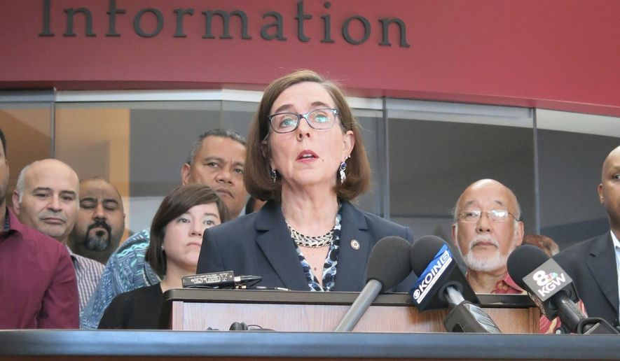 In this May 27, 2017, file photo, Oregon Gov. Kate Brown speaks at a news conference in Portland, Ore.  A bill signed Tuesday, Aug. 15 2017, by Oregon's governor has reclassified personal-use possession of cocaine, methamphetamine and other drugs as a misdemeanor from a felony. The bill also directs a state commission to develop methods for recording data concerning police-initiated pedestrian and traffic stops that is aimed at ensuring police aren't stopping people based on racial or other profiling.  (AP Photo/Gillian Flaccus, File)