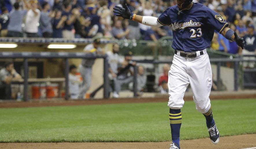 Milwaukee Brewers' Keon Broxton celebrates as he crosses the plate after hitting a home run during the seventh inning of a baseball game against the Pittsburgh Pirates Tuesday, Aug. 15, 2017, in Milwaukee. (AP Photo/Morry Gash)