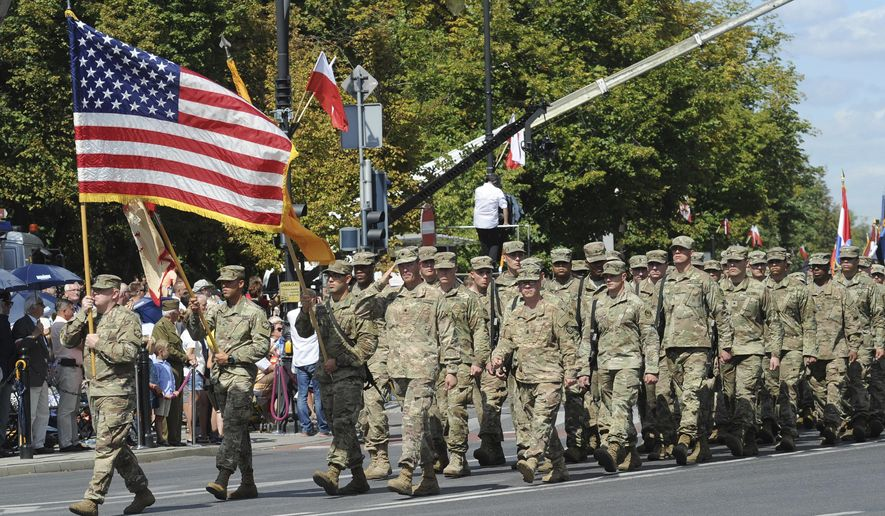 A U.S. Army unit marches during a yearly military parade celebrating the Polish Army Day, in Warsaw, Poland, Tuesday, Aug. 15, 2017. (AP Photo/Alik Keplicz)
