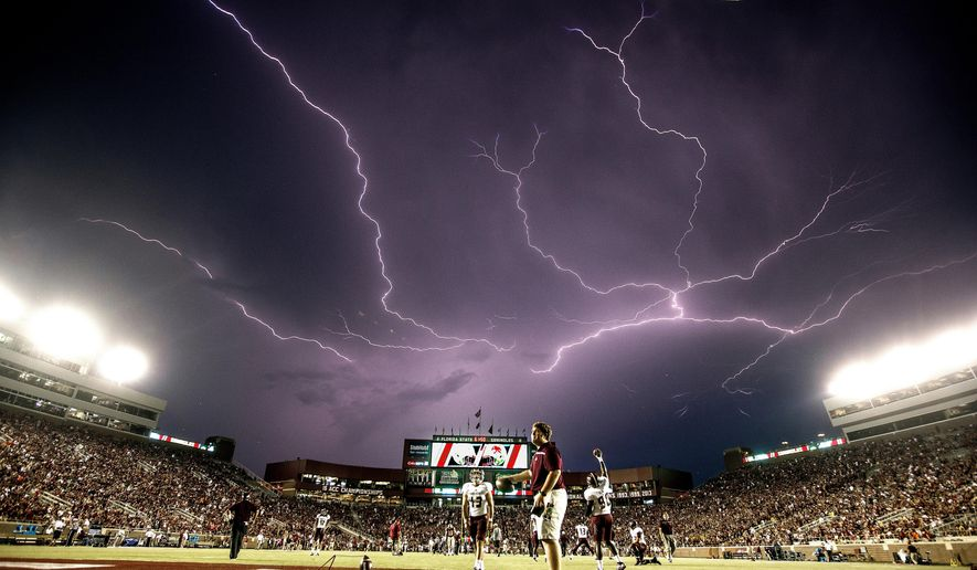 In this Sept. 5, 2015, file photo, a lightning strike occurs as Texas State warms up in Doak Campbell Stadium prior to an NCAA college football game against Florida State in Tallahassee, Fla. Lightning used to kill about 300 Americans a year, but lightning deaths are on pace to hit a record low this year. Scientists say less time spent outside and improved medical treatment have contributed to fewer deaths. (AP Photo/Mark Wallheiser, File)