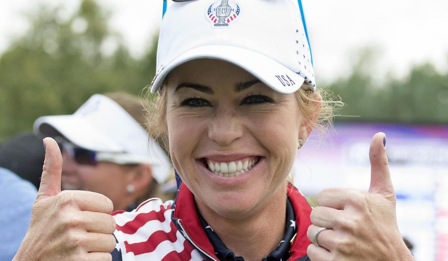 FILE - In this Sept. 20, 2015, file photo, Paula Creamer celebrates at the Solheim Cup golf tournament in St. Leon-Rot, southern Germany, after defeating Germany's Sandra Gal.  After making the U.S. team for the Solheim Cup six times in a row, Paula Creamer lost her spot. But captain Juli Inkster gave Creamer a reprieve as an alternate, and she'll head into this weekend's tournament looking to find her game again. (AP Photo/Jens Meyer, File)