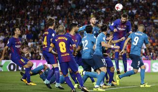 FC Barcelona's Gerard Pique, second from right, heads the ball during the Spanish Supercup, first leg, soccer match between FC Barcelona and Real Madrid at Camp Nou stadium in Barcelona, Spain, Sunday, Aug. 13, 2017. (AP Photo/Manu Fernandez)