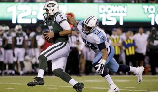 New York Jets quarterback Christian Hackenberg (5) is sacked by Tennessee Titans outside linebacker Aaron Wallace (52) during the third quarter of an NFL football game, Saturday, Aug. 12, 2017, in East Rutherford, N.J. (AP Photo/Julio Cortez)