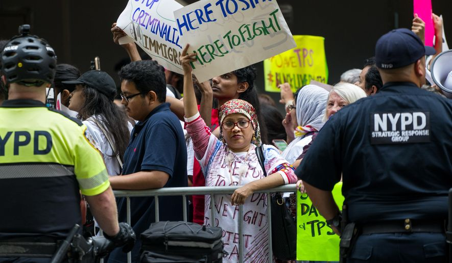 Activists supporting Deferred Action for Childhood Arrivals (DACA), and other immigration issues gather near Trump Tower in New York Tuesday, Aug. 15, 2017, as they protest President Donald Trump. (AP Photo/Craig Ruttle)
