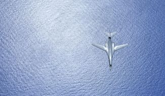 In this image provided by the U.S. Air Force, a U.S. Air Force B-1B Lancer assigned to the 37th Expeditionary Bomb Squadron, deployed from Ellsworth Air Force Base, South Dakota, in flight during a 10-hour mission from Andersen Air Force Base, Guam, flying in the vicinity of Kyushu, Japan, the East China Sea, and the Korean peninsula, Aug. 7, 2017 (HST). (Airman 1st Class Gerald Willis/U.S. Air Force via AP)