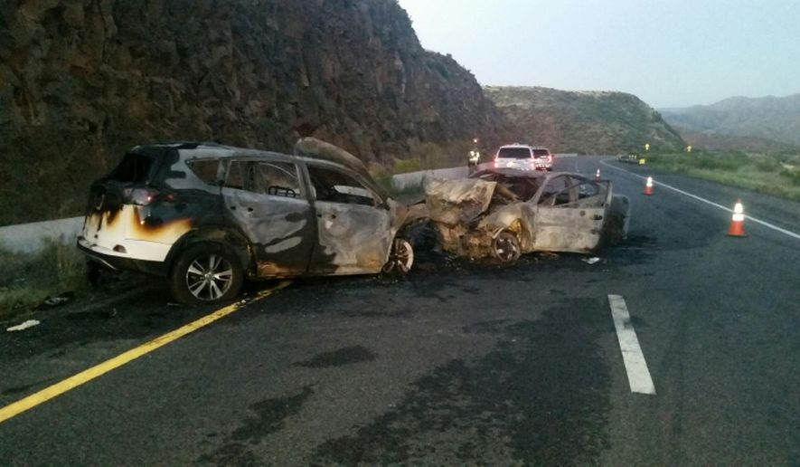 This photo provided by the Arizona Department of Public Safety shows a mangled car wreck along southbound Interstate 17, north of Black Canyon City, Ariz., Tuesday, Aug. 15, 2017, in a rural area following a wrong-way crash that authorities say injured at least four people. The Daisy Mountain Fire Department says four people were transported by helicopter and ambulance after the wreck early Tuesday morning. (Arizona Department of Public Safety via AP)