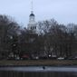 A rower paddles down the Charles River near the campus of Harvard University in Cambridge, Mass., Tuesday, March 7, 2017. (AP Photo/Charles Krupa) (Associated Press)