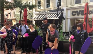 Activists show up to the Charlottesville, Virginia, funeral service for Heather Heyer wielding pink baseball bats and purple shields, Aug. 16, 2017. (Twitter, Taylor Lorenz)