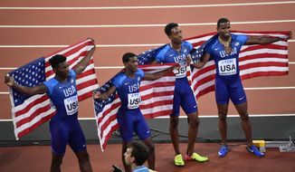 United States' Men's 4x400-meter relay team celebrate after their silver medal at the World Athletics Championships in London Sunday, Aug. 13, 2017.(AP Photo/Martin Meissner)
