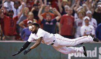 Boston Red Sox's Jackie Bradley Jr. goes airborne toward home plate as he tries to beat the throw while scoring on the game-winning, two-run double by Mookie Betts during the ninth inning of a baseball game against the St. Louis Cardinals in Boston, Wednesday, Aug. 16, 2017. The Red Sox won 5-4. (AP Photo/Charles Krupa)
