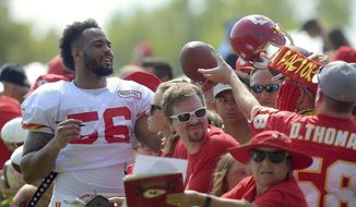 Kansas City Chiefs linebacker Derrick Johnson signs autographs after an NFL football practice Tuesday, Aug. 15, 2017, in St. Joseph, Mo. (Jessica A. Stewart/The St. Joseph News-Press via AP)