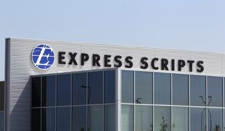 FILE - This July 21, 2011, file photo shows a building on the Express Scripts campus in Berkeley, Mo. Express Scripts, the nation's largest pharmacy benefits manager, will limit the number and strength of opioid drugs prescribed to first-time users starting in September 2017 as part of a wide-ranging effort to curb an epidemic affecting millions of Americans. The new program is drawing criticism from the American Medical Association. (AP Photo/Jeff Roberson, File)
