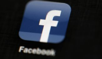 FILE - In this May 16, 2012, file photo, the Facebook logo is displayed on an iPad in Philadelphia. Facebook told The Associated Press on Aug. 16, 2017,  it has banned the Facebook and Instagram accounts of one of a white nationalist who attended a rally in Charlottesville, Virginia, that ended in deadly violence. (AP Photo/Matt Rourke, File)