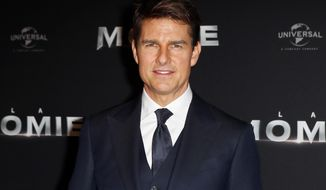 """FILE - In this Tuesday, May 30, 2017, file photo, Tom Cruise poses during a photocall for the French premiere of """"The Mummy"""" in Paris, France. Production has shut down on """"Mission: Impossible 6"""" due to Cruise's broken ankle. Paramount Pictures said Wednesday, Aug. 16, 2017, that production will go on hiatus while Cruise makes a full recovery.Cruise broke his ankle while performing a stunt for the film during its London-based shoot. (AP Photo/Francois Mori, File)"""