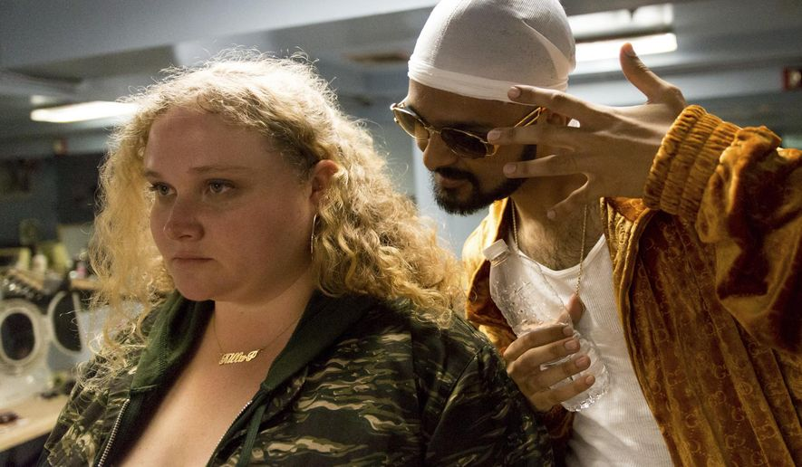 "This image released by Fox Searchlight shows Danielle Macdonald, left, and Siddharth Dahanajay in ""Patti Cake$."" (Jeong Park/Fox Searchlight via AP)"