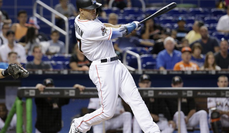 Miami Marlins' Giancarlo Stanton hits a single during the first inning of a baseball game against the San Francisco Giants, Wednesday, Aug. 16, 2017, in Miami. (AP Photo/Lynne Sladky)