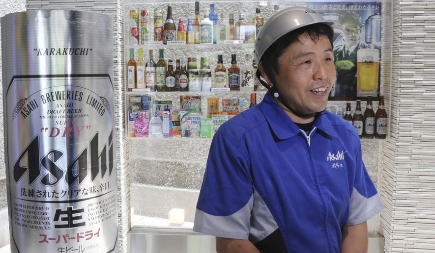 In this Monday, May 29, 2017 photo, Asahi Breweries employee Kiyoshi Sakai speaks during an interview at a factory in Moriya near Tokyo. Sakai, who has worked at Asahi for 29 years, recalls those days the caps for beer cans had to be placed into machines by hand, a repetitive task that was hard not just on the body but the mind. And so he is grateful for the helping hand from automation. (AP Photo/Koji Sasahara)