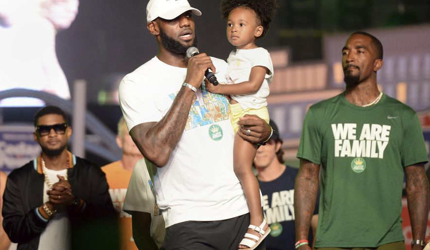 Cleveland Cavaliers' LeBron James speaks while holding his daughter, Zhuri, during the We Are Family Reunion at Cedar Point in Sandusky, Ohio, Tuesday, Aug. 15, 2017. (Erin McLaughlin/The Sandusky Register via AP)