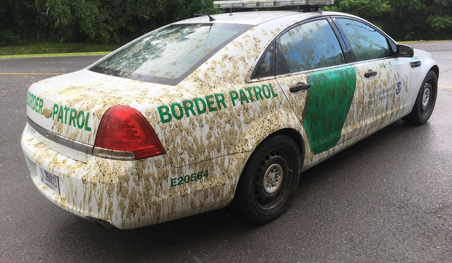 This Aug. 3, 2017 photo provided by U.S. Customs and Border Protection shows a U.S. Border Patrol car that had been sprayed with manure in Alburgh, Vt. Mark Johnson is charged with spraying liquid manure on a marked U.S. Customs and Border Protection car after confronting an agent about immigration enforcement. (U.S. Customs and Border Protection via AP)