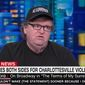 """Liberal filmmaker Michael Moore made the explosive claim Tuesday night that Americans who voted for President Trump are complicit in his """"racism"""" in the same way that a person who is an accomplice of rape could be considered a rapist. (CNN)"""