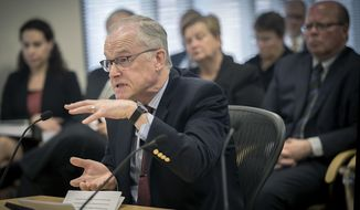 Dean John Finnegan responds to a report regarding the handling of the Minnesota football scandal before the Board of Regents, during a meeting at the U of M McNamara Alumni Center, Wednesday, Aug. 16, 2017, in Minneapolis, Minn. The University of Minnesota followed law and policy properly when it suspended 10 football players last fall following an accusation of sexual assault, an outside review found.(Elizabeth Flores /Star Tribune via AP)