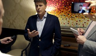 New York Yankees owner Hal Steinbrenner talks with reporters following a meeting with Major League Baseball owners, Wednesday, Aug. 16, 2017, in Chicago. (AP Photo/Nam Y. Huh)