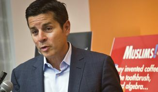 """In this June 25, 2015, file photo, Muslim comedian Dean Obeidallah speaks at a news conference in New York. Obeidallah, a Muslim-American radio host, is accusing Andrew Anglin, the publisher of a notorious neo-Nazi website, of defaming him by falsely labeling him the """"mastermind"""" of a deadly concert bombing in England, according to a federal lawsuit filed Wednesday, Aug. 16, 2017. (AP Photo/Bebeto Matthews, File) **FILE**"""