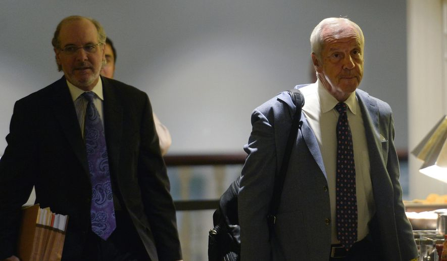 North Carolina basketball coach Roy Williams and his lawyer Jim Cooney, left, arrive at an NCAA hearing Wednesday, Aug. 16, 2017, in Nashville, Tenn. It has taken more than two years for North Carolina to appear before an NCAA infractions committee panel since initially being charged with five top-level violations amid its long-running academic scandal. (AP Photo/Mark Zaleski)