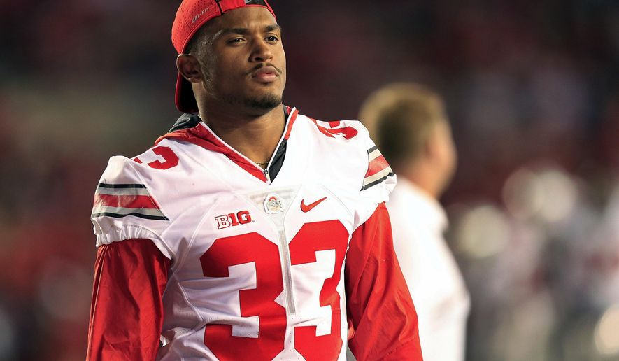 This Oct. 15, 2016, photo shows Ohio State Buckeyes linebacker Dante Booker watching the game against Wisconsin Badgers in Madison, Wisconsin. After he injured his knee in the season opener last year, linebacker Dante Booker was a man in limbo. Booker is healthy now, and again has earned a starting outside linebacker spot. (Kyle Robertson/The Columbus Dispatch via AP)