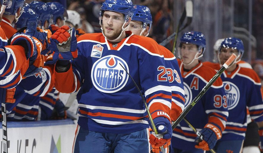 FILE - In this Thursday, Feb. 16, 2017 file photo, Edmonton Oilers center Leon Draisaitl (29) celebrates a goal against the Philadelphia Flyers during the first period of an NHL hockey game in Edmonton, Alberta. The Edmonton Oilers have signed center Leon Draisaitl to an eight-year contract extension with an average annual value of $8.5 million. The extension runs through the 2024-25 season, Wednesday, Aug. 16, 2017. (Jason Franson/The Canadian Press via AP, File)