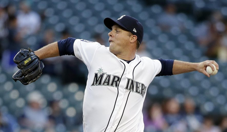 Seattle Mariners starting pitcher Andrew Albers throws against the Baltimore Orioles in the first inning of a baseball game Tuesday, Aug. 15, 2017, in Seattle. (AP Photo/Elaine Thompson)