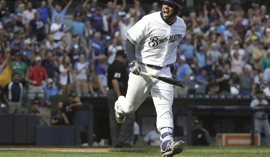 Milwaukee Brewers' Manny Pina hits a two-run home run during the eighth inning of a baseball game against the Pittsburgh Pirates Wednesday, Aug. 16, 2017, in Milwaukee. (AP Photo/Morry Gash)