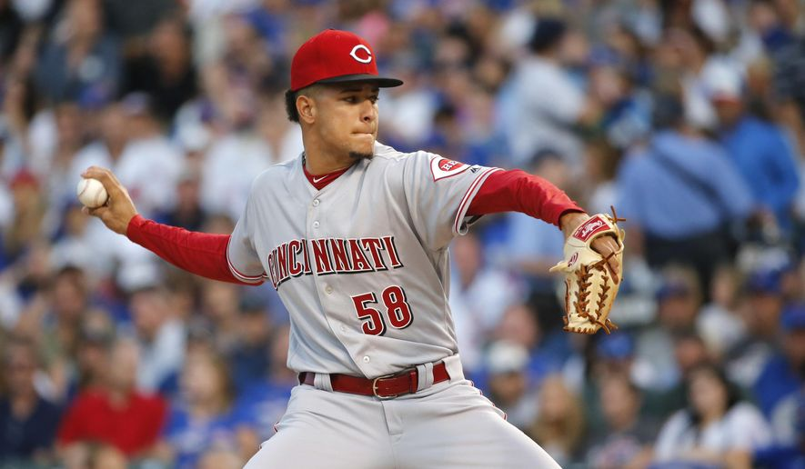 Cincinnati Reds starting pitcher Luis Castillo delivers during the first inning of a baseball game against the Chicago Cubs, Tuesday, Aug. 15, 2017, in Chicago. (AP Photo/Charles Rex Arbogast)