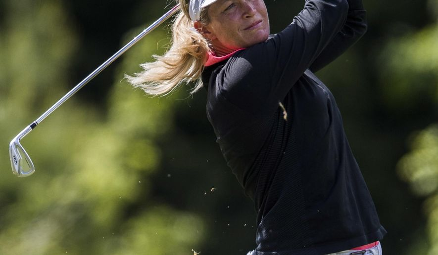 FILE - In this June 9, 2017, file photo, Suzann Pettersen, of Norway, tees off on the 17th hole during the second round of the LPGA Classic at Whistle Bear Golf Club in Cambridge, Ontario. European golfer Suzann Pettersen has pulled out of this weekend's Solheim Cup because of a back injury. Pettersen, who has 12 top-20 finishes and a win this season on the LPGA Tour, will be replaced by alternate Catriona Matthew. (Mark Blinch/The Canadian Press via AP)